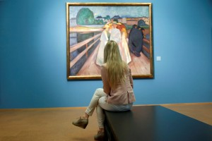 A-visitor-looks-at-a-painting-The-ladies-on-the-bridge-on-May-31-2013-at-the-National-Gallery-in-Oslo