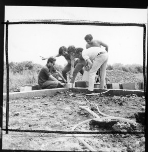 Placing te cornerstone of the Ecol house, Montreal, June, 1972. From left to right, Salama Saad, Witold Rybczynski, Arthur Acheson, Samir Ayad, and Wajid Ali.