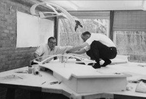 Eeero Saarinen and Kevin Roche with model of TWA, 1957